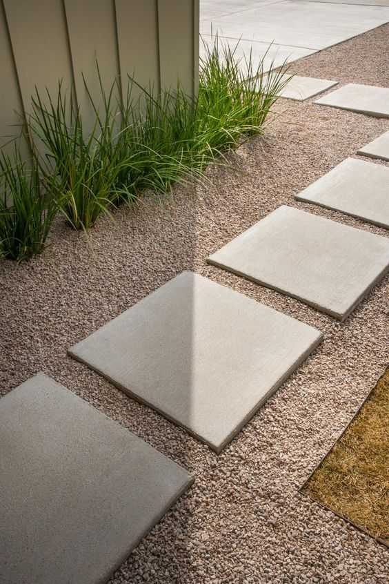 Clean lines signify modern style. Just a few perfectly aligned large pavers make an big impact. Via HGTV