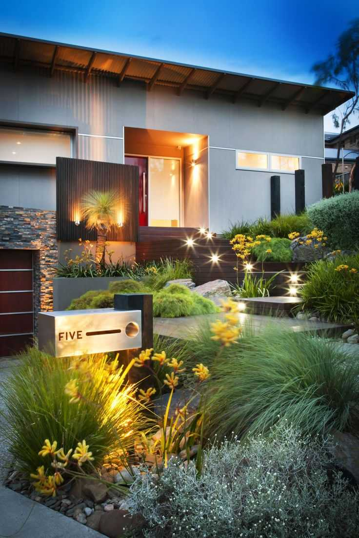 Here's another stunning example of landscaping which imitates features of the house. See how the yellow flower heads seem like an extension of this home's lighting? Via Renoguide