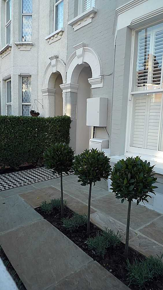 A lot can be done with limited space just by adding an interesting front pathway and several statement trees. Via London Garden Blog