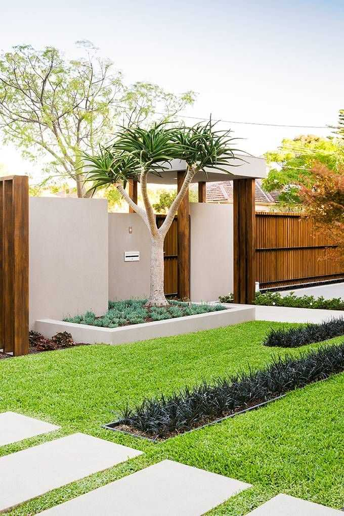 For modern landscaping, use non-flowering plants with leaves in varying shades of green. Via Renoguide